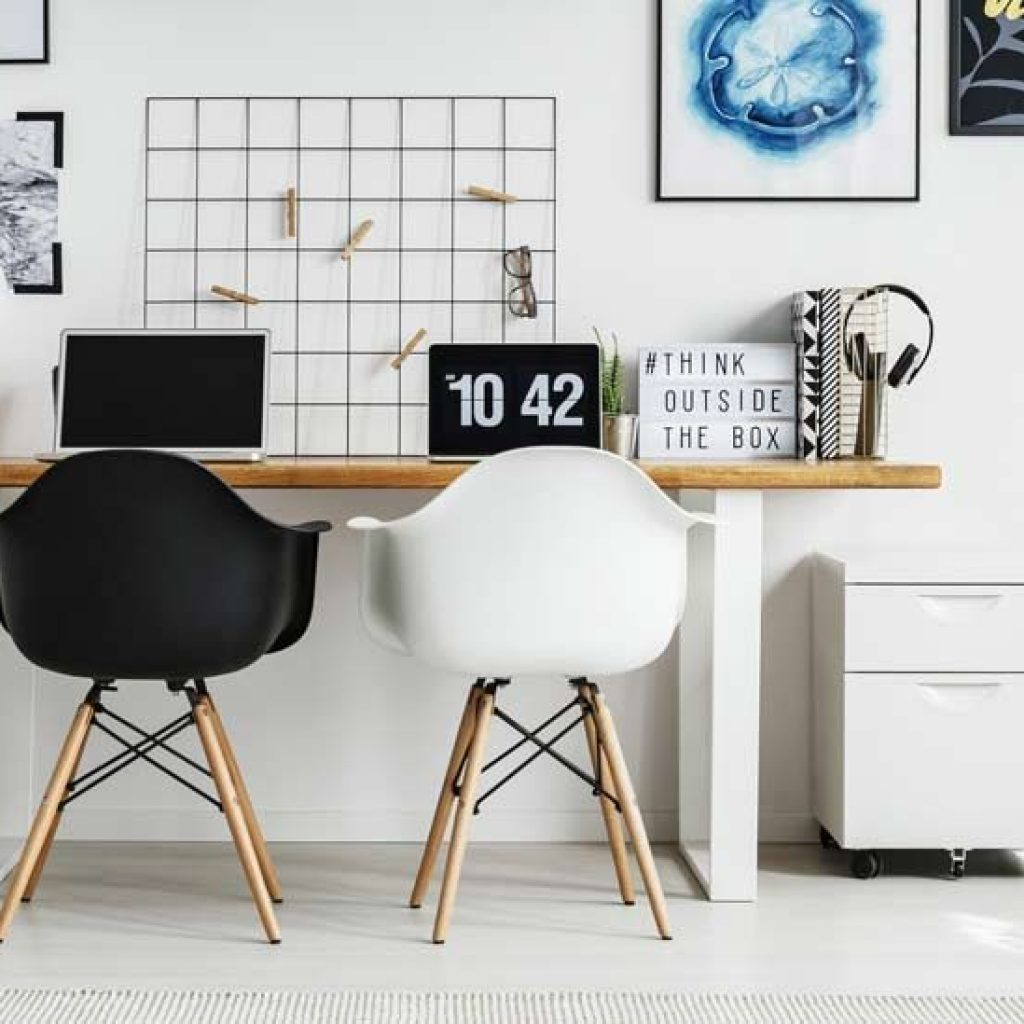 home office with chairs and laptops