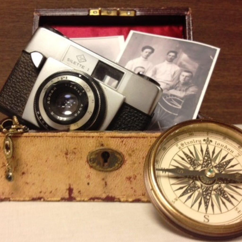 vintage camera, compass and family photos