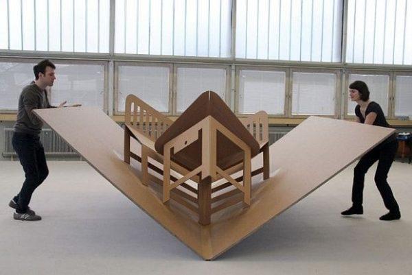 man and woman folding furniture