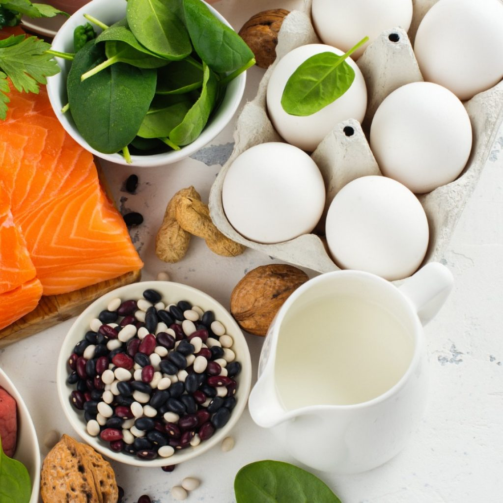 table filled with food including salmon and eggs