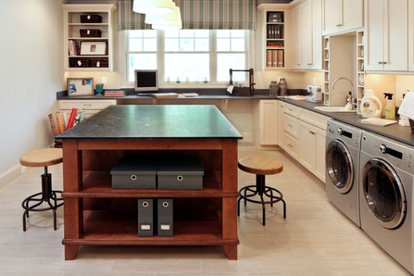 a multi functional room with an office desk and kitchen counter tops