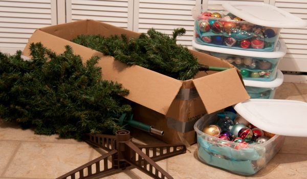 Christmas tree parts and christmas ornaments in storage containers