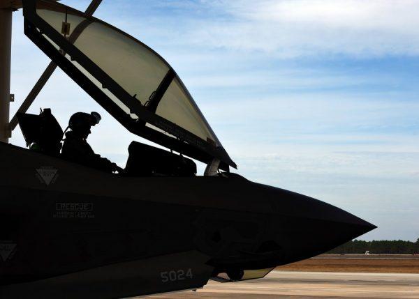 An airman sitting inside a jet